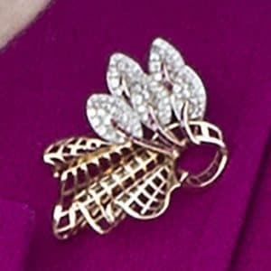 Queen Elizabeth II's gold-and-diamond trellis brooch, worn at the Commonwealth baton relay start in March 2017