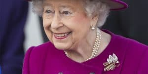 Queen Elizabeth II wearing gold-and-diamond royal brooch at Commonwealth baton relay launch at Buckingham Palace, March 2017