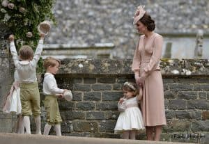 Kate Middleton Duchess of Cambridge in Alexander McQueen with Prince George and Princes Charlotte at wedding of sister Pippa Middleton
