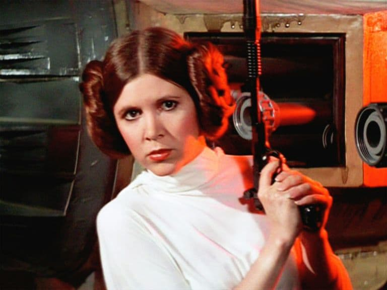 Princess Leia holding a blaster in Star Wars A New Hope Carrie Fisher