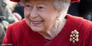 Queen Elizabeth II ruby gold trellis brooch church service Sandringham 2018
